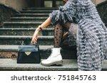 stylish woman in rich fur coat... | Shutterstock . vector #751845763