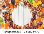 mix of dried fruits and nuts on ...   Shutterstock . vector #751875973