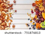 mix of dried fruits and nuts on ... | Shutterstock . vector #751876813