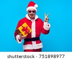 santa claus. young man with... | Shutterstock . vector #751898977