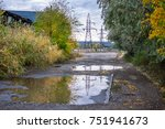 old road with puddles in the...   Shutterstock . vector #751941673
