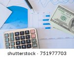Small photo of Accounting data, charts, calculator and pen. Many charts and graphs. Reflection background.