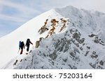 Team Of Two Alpinists Climbing...
