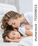 mother kisses daughter before... | Shutterstock . vector #752058013