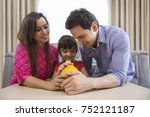 parents and daughter saving... | Shutterstock . vector #752121187