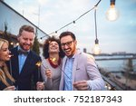 four friends holding sparklers | Shutterstock . vector #752187343