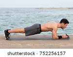 athletic man during forearm... | Shutterstock . vector #752256157
