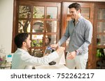 attractive young man buying... | Shutterstock . vector #752262217
