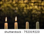 two burning candles on the... | Shutterstock . vector #752319223