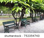 Wooden Bench Under Arbor In Th...