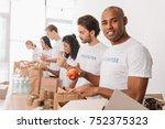 african american volunteer... | Shutterstock . vector #752375323