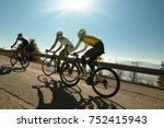 bikers uphill just before the... | Shutterstock . vector #752415943