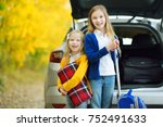 two adorable girls with a... | Shutterstock . vector #752491633