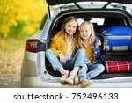 two adorable girls sitting in a ... | Shutterstock . vector #752496133