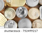 tin cans on wooden background ... | Shutterstock . vector #752499217