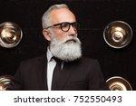 pensive man in fashion glasses... | Shutterstock . vector #752550493