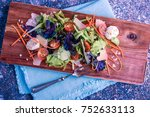 salad on a wooden board with a... | Shutterstock . vector #752633113