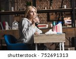 sick middle aged woman drinking ... | Shutterstock . vector #752691313