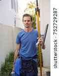 window cleaning man with tools   Shutterstock . vector #752729287