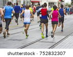 marathon runners race in city... | Shutterstock . vector #752832307