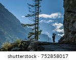 a local woman carrying a heavy... | Shutterstock . vector #752858017