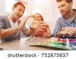 Young People Play A Board Game...