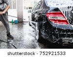 car washing. cleaning car using ... | Shutterstock . vector #752921533