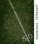 Small photo of Football field ground fifty yard line. Friday night lights.