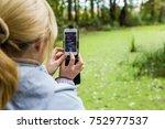 a blonde woman using a phone...   Shutterstock . vector #752977537