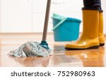 maid in gumboots mopping tiled... | Shutterstock . vector #752980963