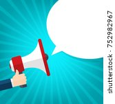 human hand holding megaphone... | Shutterstock .eps vector #752982967