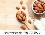 almond in a bowl with almonds... | Shutterstock . vector #753065977