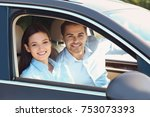 beautiful young couple in car | Shutterstock . vector #753073393