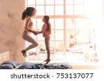 beautiful mom and daughter are... | Shutterstock . vector #753137077