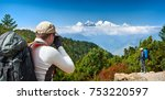 couple tourists with backpacks... | Shutterstock . vector #753220597