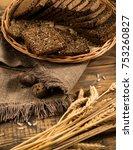 rye bread in a wicker tray with ... | Shutterstock . vector #753260827