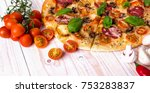 pizza with salami vegetables... | Shutterstock . vector #753283837