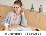 pretty female student sits at...   Shutterstock . vector #753343513