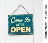 Small photo of come in we're open sign