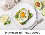 toast with avocado  spinach and ... | Shutterstock . vector #753380983