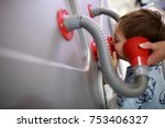 Small photo of Child is studying acoustics in a museum