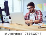 concentrated young man working... | Shutterstock . vector #753412747