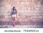 young woman in shorts with long ... | Shutterstock . vector #753490513