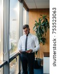 the office manager is standing... | Shutterstock . vector #753523063