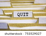 Small photo of Quit word on card index paper