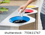 hand putting paper waste into... | Shutterstock . vector #753611767
