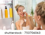 young beautiful woman cleaning... | Shutterstock . vector #753706063
