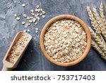 rolled oats or oat flakes in... | Shutterstock . vector #753717403