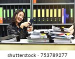 lazy asian office woman using... | Shutterstock . vector #753789277