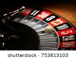 Small photo of Macro shot of a roulette in a casino where the ball goes to the green or red or black number. People having bet and bet money may have won lost badges. Concept of: fate, gambling, luck, destiny.